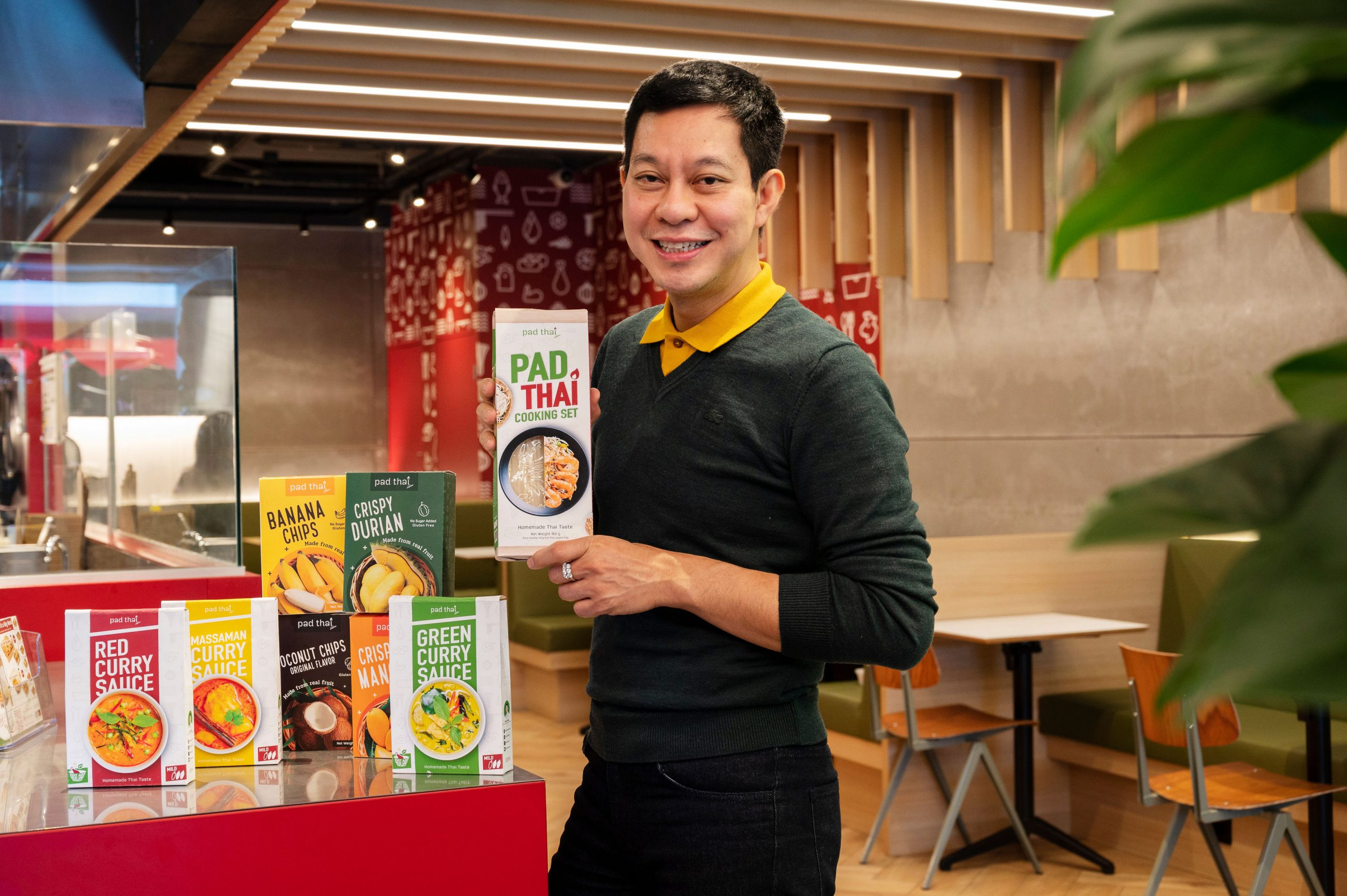 Pad Thai's founder Tham holding a package of the Pad Thai Cooking Set